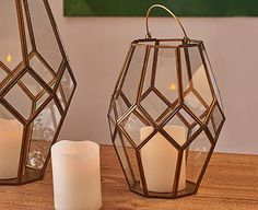 Original Gift Company Nkuku Small Mohani Lantern Cast the warm glow of candlelight around a seating or eating area with this charming glass lantern. Beautifully handmade by skilled craftsmen, it features a striking geometric design in brass and glas http://www.MightGet.com/february-2017-2/original-gift-company-nkuku-small-mohani-lantern.asp