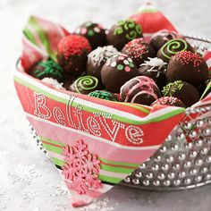 Chocolate Doughnut Delights -  Chocolate-dipped doughnut holes get a holiday makeover with coconut, sprinkles, and edible glitter. For a lovely gift, place them in a pretty tin lined with a colorful napkin.  So pretty!