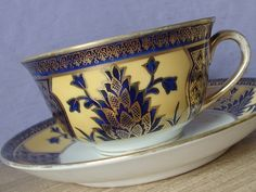 Antique 1920's Noritake china hand painted tea cup set, vintage blue and gold tea set, porcelain tea cup, Japanese tea cup and saucer by ShoponSherman on Etsy https://www.etsy.com/listing/152903084/antique-1920s-noritake-china-hand