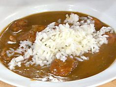 Get this all-star, easy-to-follow Quail and Smoked Sausage Christmas Gumbo recipe from Emeril Lagasse