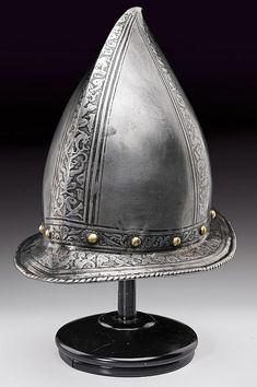 An engraved officer's morion, dating: circa 1600  provenance: North Italy