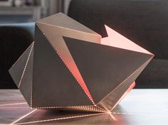 The Folding Lamp designed by Belgian architect Thomas Hick…