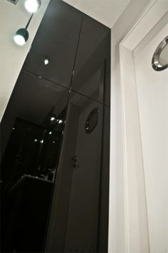 black glossy closett in bathroom