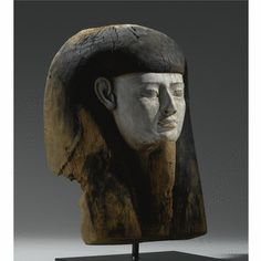 A Wood Mummy Mask, 26th/30th Dynasty, 664-342B.C.