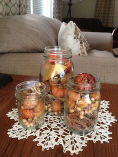 Super easy (and cheap) fall centerpiece, table decoration or for a mantel. Fill different sized mason jars with potpourri.