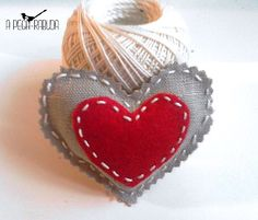 Linen and felt heart, stuffed with lavender, hand stitched.  For drawers, doors, key holders. or simply to offer those you love.