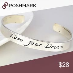 """Dreams Bangle """"Live your dreams"""" bangle silver plated statement bracelet. Gorgeous reminder of who you are and to always be who you want to be in your life. One size fits all wrists. Silver plated bangle. HOLIDAY HOLIDAY SALE Bundle 2 or more items to receive 30% off October Love Jewelry Bracelets"""