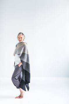 This dramatic wrap uses a color gradient to striking, modern effect. Knit loosely on the bias in garter stitch with a crisp and simple slipped-stitch edging, Loft creates a plush, light fabric to drape you in effortless style. Work the small version for a long, narrow scarf or the large version for a generous wrap.