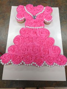 Princess Dress Cupcake Cake-- 28 Cupcakes, buttercream icing, white Sixlets from the baking aisle for detail.