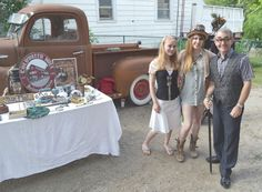 PATRICK BALES/THE PACKET & TIMES Simcoe North MP Bruce Stanton was outfitted in steampunk attire Tuesday to present the Coldwater Steampunk Festival with a $4,400 grant from Heritage Canada. He was joined by steampunkers Emma Vander Meer, left, and Katie Drummond.