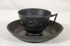Rare Set of a Dozen Wedgwood Black Basalt Tea Cups and Saucers | From a unique collection of antique and modern tea sets at https://www.1stdibs.com/furniture/dining-entertaining/tea-sets/
