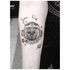 Este gato que está pronto para decolar. | 21 tatuagens espaciais que são totalmente de outro mundo