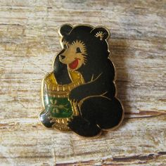 This listing is vintage pin which was made in a shape of a bear, a cartoon…