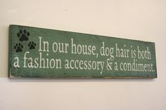 This is a wood sign made of sanded plywood that measures 24 x 6. The background is painted wedgwood green. Wording is cream with black design.