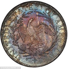 This 1797 half dollar coin, pictured heads-down, is worth up to $1.75million...