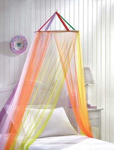 Heavenly Rainbow Bed Canopy.    Sweet dreams are assured as your little princess slumbers beneath this dreamy, ice-creamy tulle netting canopy! A flowing, floating rainbow gently drapes your child's bed in a transparent cloud of color... a pure delight for anyone who believes in fairy tales! #kids #home #decor $7.98