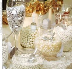 "To end the night, guests could stop at the candy bar to create their own favors. ""There were Chinese takeout boxes with our monogram so guests could take the assorted white and cream-colored candies home,"""