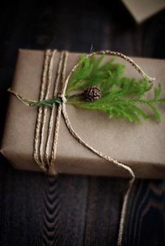 Christmas wrapping or gift wrap for a green winter wedding. Recycled craft paper and fresh greens.