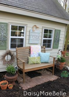 """** Great idea to add a bench!  I really like the shutters and the iron decor on them!!  The """"relax"""" sign is another nice touch!"""