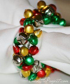 How to make Jingle Bell napkin rings. These are so cute for Christmas and just like the ones at Pier I was shopping at Pier 1 the other day and I came across some cute little jingle bell napkin rings. I made it my mission to make my own! Diy Christmas Napkins, Christmas Tree Napkin Fold, Christmas Ring, Christmas Bells, Christmas Angels, Christmas Crafts, Christmas Decorations, Crochet Christmas, Christmas Christmas