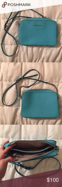 Michael Kors Crossbody Bag Beautiful tiffany blue Michael Kors crossbody bag. Adjustable straps. Only worn once. It's a perfect statement bag! Michael Kors Bags Crossbody Bags