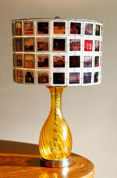 Love this Lampshade made from vintage slides with amber glass base.. $320.00, via Etsy.