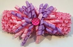 Wider crocheted Headband accented w/ Pink & Purple curled ribbon accented with a poka dot button. Can be worn centered or side. Perfect addition to Baby pictures!  by RockinRobinsBling, $5.00