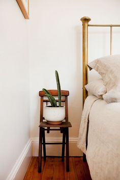 charming chair as side table with a plant of course