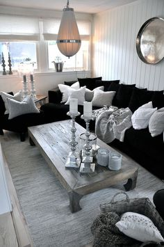 Black Couch White Knitted Pillows Light Wood And Silver Accents In Painted Paneled Room