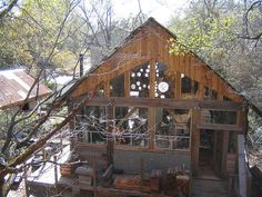 The Tree House, located in Huntsville, Texas is Dan Phillips' first artist compound complete with main house, efficiency apartment, working studio, and large outdoor patio area. The main house sits in a Bois d'arc tree thirty-five feet above Huntsville's Town Creek. Artists must have a legitimate portfolio in order to rent the Tree House. Just outside of the tree house itself is a multipurpose art studio. The ceiling is covered with discarded frame samples from frame shops. It includes lots…