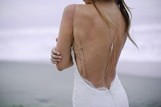 Beach bride wearing backless wedding dress with temporary poetry tattoo on fingers, back and legs for beach wedding.