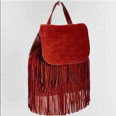 ❗️LAST CHANCE Urban Outfitters Tassel Backpack NWT ❗️LAST CHANCE Urban Outfitters Brown Tassel Backpack! Brand NWT retails $109. All details in pic 4. I consider all strong offers so feel free to make an offer & it's yours! Snatch it up before someone else does! ASAP shipping! Extra 30% off on bundles! Suggested User  Urban Outfitters Bags Backpacks