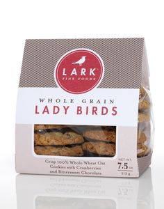 WHOLE GRAIN LADY BIRDS  Crisp 100% whole wheat oat cookies with cranberries and bittersweet chocolate.