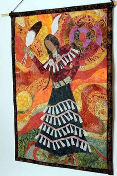 Quilted wall hanging of Native American Jingle Dress Dancer. $240.00, via Etsy.