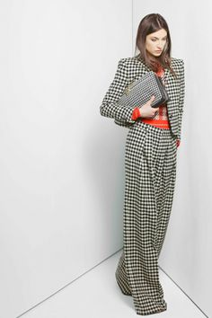 Chloé gets involved with some pattern play, mixing plaid with a head-to-toe houndstooth suit that we're sure will be spotted on execs and fashion editors alike next fall.