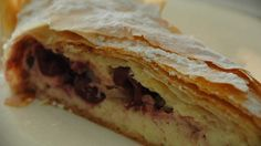 Nan's cherry cream cheese strudel | This dessert is aluscious mixture of cherries, ricotta and cream cheese encased in golden flaky pastry from a great cook, Janelle Bloom, via a recipe from her Hungarian grandmother. If time allows, drain the ricotta in the fridge for 1–2 hours before making the filling.