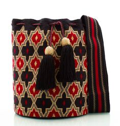 Exclusive SUSU Accessories collection Cross-body BUCKET Bags, handknitted by the most talented artisans of the Wayuu ethnicity in Colombia. Crochet Stitches Chart, Tapestry Crochet Patterns, Tapestry Bag, Boho Bags, Crochet Purses, Knitted Bags, Crochet Accessories, Crochet Designs, Hand Knitting