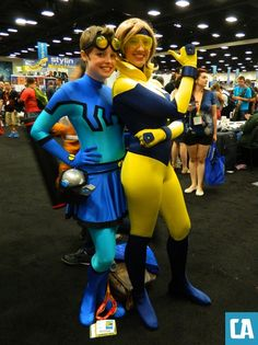 Awesome cosplay of a female Blue Beetle and Booster Gold.