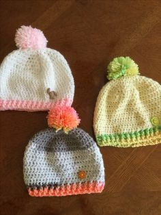 Put some pizazz in your double crochet beanie with a playful Pom poms.  Pom poms add the wow factor to your winter headwearThey are the perfect way to energize your beanie while designing a hat to keep you warm in cold weather.  For many more photos and ideas, see:  http://www.lilcreates.com/lillians-bllog/energize-your-crocheted-beanie-with-a-playful-beanie