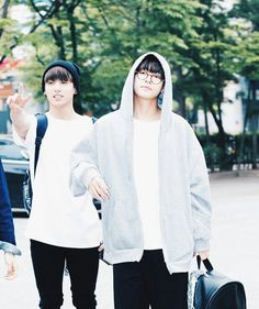 V looks like a wise professor with one of his students behind him