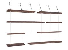 These rustic, yet dynamic wall shelves are crafted from nearly century-old reclaimed pine wood, and held in place using stainless steel cables attached to turnbuckles to save on floor space. Shelves are 11 deep in 23.5, 39 & 55 widths.