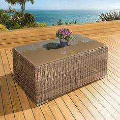 Luxury outdoor garden rectangular coffee table mocha rattan glass top. Truly stunning in design, this coffee table has a super high-class feel and is part of our mix and match sofa range. It comes with complete with a cover. Made from fully weatherproof PE rattan, hand woven over a rust resistant frame. Call 02476 642139 or email sales@quatropi.com or visit www.quatropi.com for additional information.
