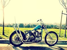 Vintage Chopper Motorcycle. Solo Seat, Trick Paint & Pipes.