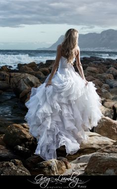 Incredible wedding dress on the rocks at ST James Beach Cape Town South Africa