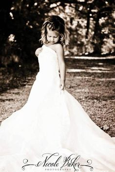 Daughter in Mom's wedding dress.   So cute!