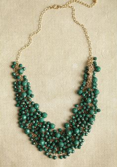 Royal Decadence Beaded Necklace In Green 16.99 at shopruche.com. Dark green beads adorn this gold-toned chain necklace for a luxurious statement look.20