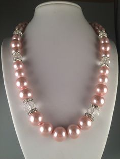A personal favourite from my Etsy shop https://www.etsy.com/au/listing/292860055/pink-glass-pearl-beaded-necklace-with