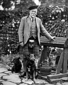 Old photograph of a Scotsman with his dogs in Aberfeldy, Highland Perthshire, Scotland