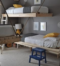 hanging beds eliminate a lot of the visual clutter...this might work in the girls' room. (love her blog, btw)