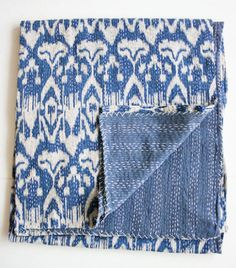 Home: Eleven Ace Quilts For Your Home  (Hand-dyed, hand-stitched Ikat Quilt in Blue. By gypsya, via Etsy)